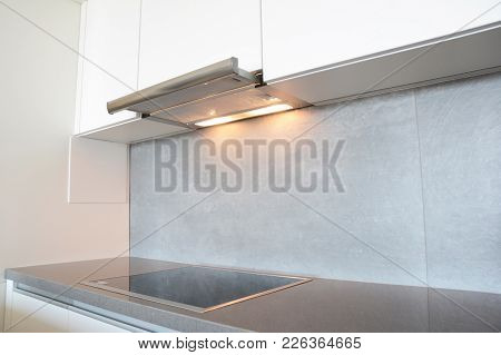 Close Up On Modern Air Exhauster Kitchen Fan Or Range Hood. Stainless Steel Chimney Hood. Island Hoo