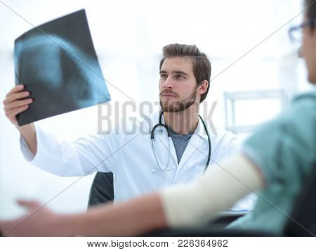 orthopedist examining a radiograph of a patient