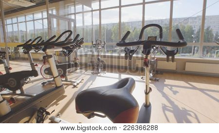 Bicycling Simulators In The Gym, Interior Of Modern Fitness Club, Background