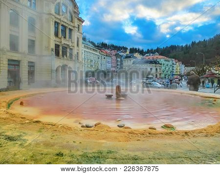 Fountain With Hot Springs - The So-called Karlovarske Vridlo - In The Historic Centre Of Karlovy Var