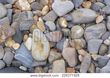 Abstract Shapes And Patterns: Stone Pebbles At Beach