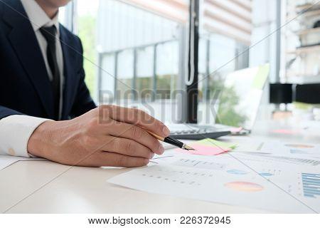 Businessman Analysis Finance Data In Paper Report.