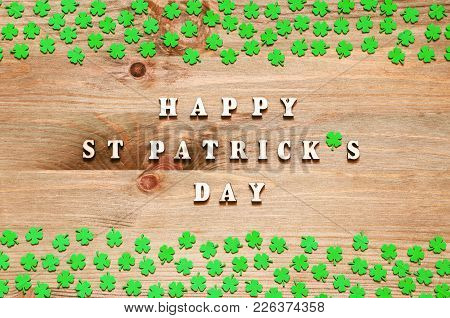 St Patricks Day Background. Green Quatrefoils On The Wooden Background And Inscription Happy St Patr