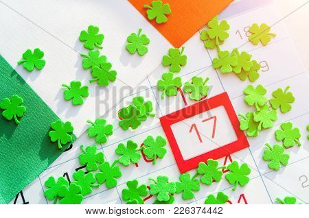 St Patrick's Day Festive Background. Green Quatrefoils And Irish Flag Covering The Calendar With Fra