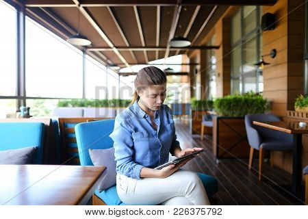 Close Up Female Hands With Long Nails Browsing By Smartphone At Cafe During Lunch. Modern Technologi