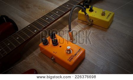 Orange And Yellow Effect Pedals On A Wooden Background