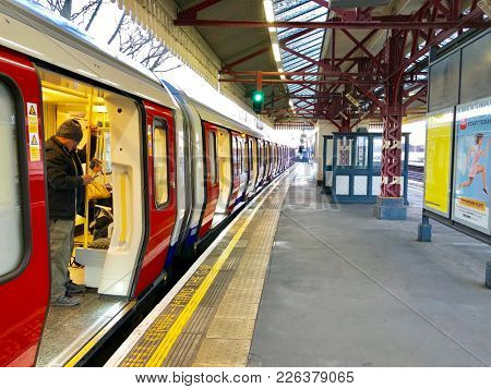 LONDON - FEBRUARY 12, 2018: London Underground District Line train in Station with doors open at Stamford Brook, Chiswick in London, UK.
