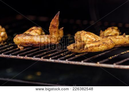 Roasted Chicken Wings On Grill In The Oven.
