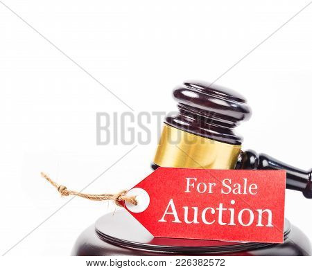 Auction Sales With Wooden Gavel On White Background. Business Concept.