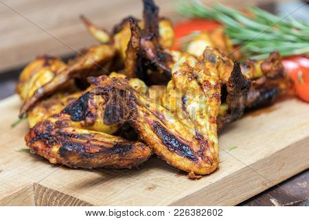 Grilled Chicken Wings On A Light Oak Surface.