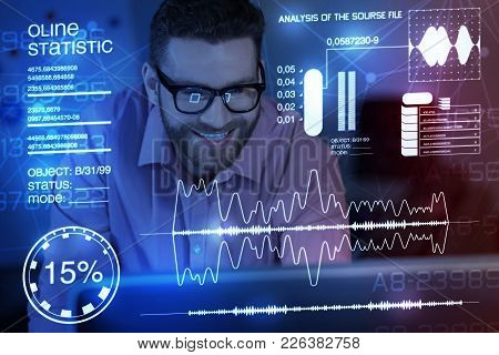 Modern Security. Cheerful Handsome It Man Programming And Smiling While Working At Night