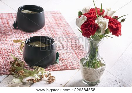 Flowers Bouquet In A Vase And Linden Tea - Bouquet Of White Roses And Red Carnations In A Cute Vase