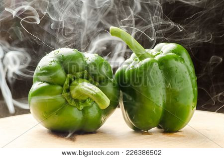 Green Bell Pepper And Smoke On Wooden