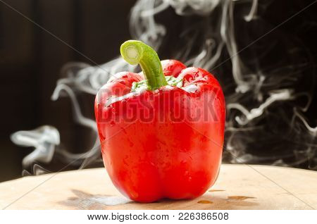 Red Bell Pepper And Smoke On Black Background