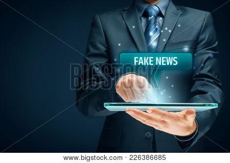 Fake News Concept. Tablet User Read Fake News.
