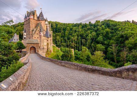 Burg Eltz castle in Rhineland-Palatinate state at sunset, Germany.