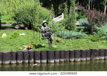 Kharkov, Ukraine - September 5, 2017: It Is The Sculpture Of Fisher Boy In The Central Park Of Cultu