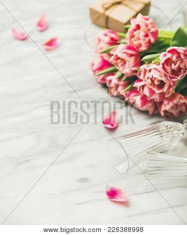 Valentines Day Holiday Background. Bouquet Of Pink Tulips, Champaign Glasses And Gift Box With Ribbo