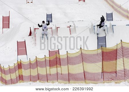 KRASNOE OZERO, LENINGRAD REGION, RUSSIA - FEBRUARY 1, 2018: Georg Hernes (left) of Norway and Miska Mustonen of Finland compete in dual mogul during Freestyle Europa Cup competitions