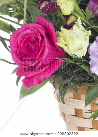 Beautiful Bright Crimson Rose In A Floral Bouquet In A Basket On A White Isolated Background