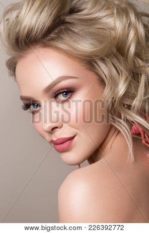 Glamour Portrait Of Beautiful Girl Model With Makeup And Romantic Wavy Hairstyle. Fashion Shiny High