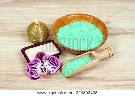 Sea Bath Salt With Herb Extract  In A Wooden  Bowl Decorated With Orchid Flower. Organic   Bath Conc