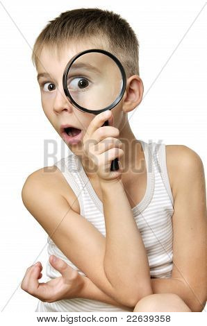 Surprised Boy With Magnifying Glass