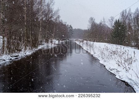 Snowing Over Water In A Chanel In Filipstad Sweden