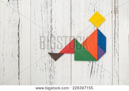 Wooden Tangram Shaped Like A People Sitting Down