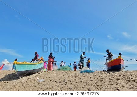 Rameshwaram, India - November, 21st, 2017. Fishermen With Their Boats On The Beach Near Small Villag
