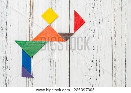 Wooden Tangram Shaped Like A People Bowing And  Taking Off His Hat With Copy Space