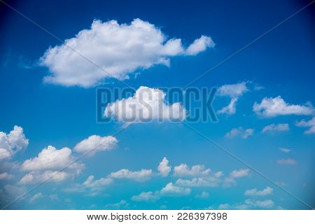 Blue Sky And White Cloud  In A Sunny Day