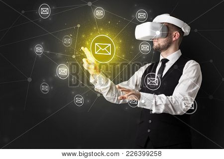 Young businessman in virtual reality glasses organize online network communication