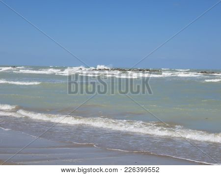 Rough Sea With Waves Splashing Crashing On The Cliff