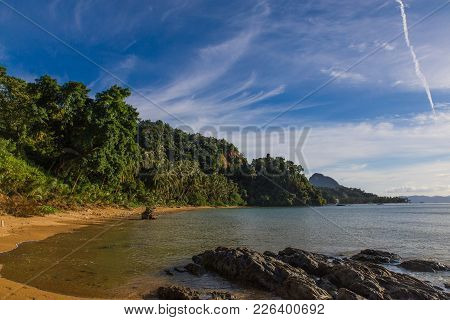 Empty Sunny Corong Corong Beach In El Nido, Palawan Province, Philippines With Stones On Foreground
