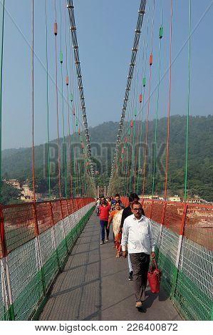 Rishikesh, India - November, 7th, 2017. Bridge Over Ganga River, Ram Jhula, Rishikesh. People Crossi
