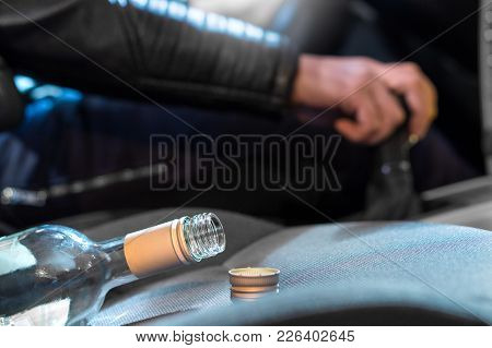 Drunk Driving Concept. Young Man Driving Car Under The Influence Of Alcohol. Hand On Gear Stick. Clo