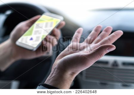 Lost And No Gps Connection. Navigation Problem. Man Using Smartphone Map Application In Car. Clueles