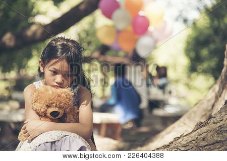 Sad Girl Feeling Alone In The Park Concept.lonely Beautiful Toddler Girl Stay Alone In The Park.