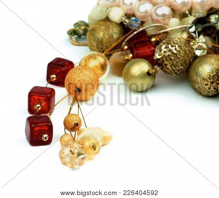 Arrangement Of Gold Pendant, Ruby Necklace, Pearl And Jewelry Closeup On White Background