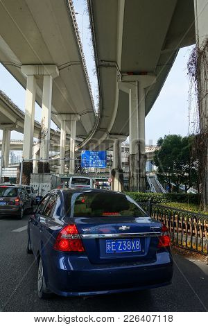 Traffic Under Modern Overpass In Shanghai