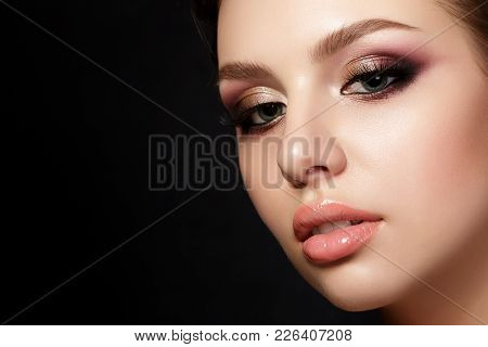 Beauty Portrait Of Young Woman With Fashion Make Up. Perfect Skin And Colorful Smokey Eyes Makeup. S