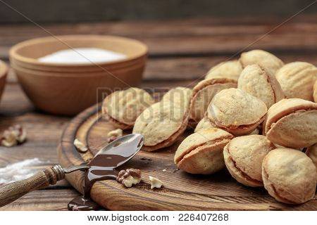 Homemade Cookies Shaped Nuts With Cream Boiled Condensed Milk On Wooden Table. Rustic Style