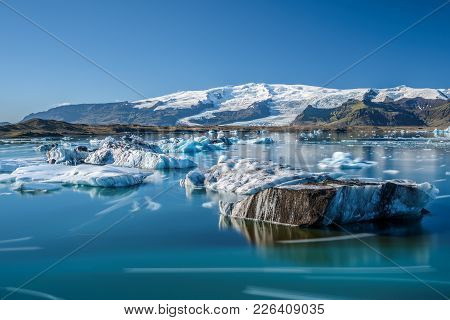Floating Icebergs In Jokulsarlon Glacier Lagoon, Iceland. Jokulsarlon Is A Glacial Lake In Southeast