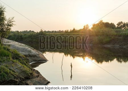 View On The River Bank And Sunrise Over It
