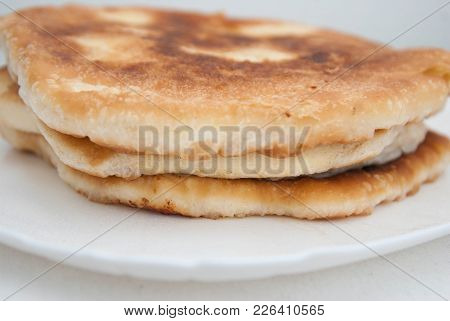 Traditional Russian Pasties Circle Pie With Cheese. Close Up Cheese Pie