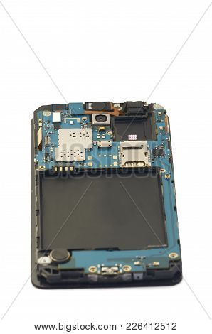 Disassembly Of Smartphone Showing Electrical Board Inside. The Phone Is Fixing