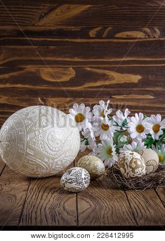 Easter Background. Handmade Easter Eggs And Flowers, On A Wood Background. Exclusive Ostrich Easter