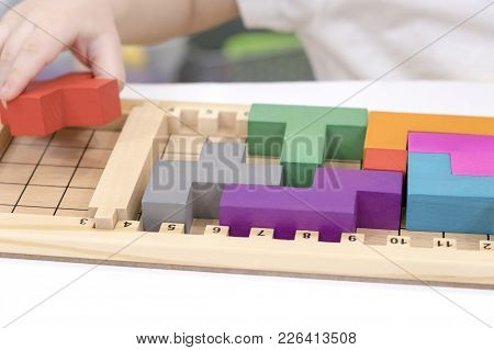 Close Up Of Child's Hands Playing With Colorful Wooden Bricks At The Table. Toddler Having Fun And B