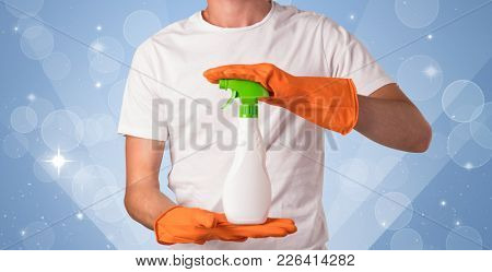 Glittered blue background with male housekeeper and cleaning equipment